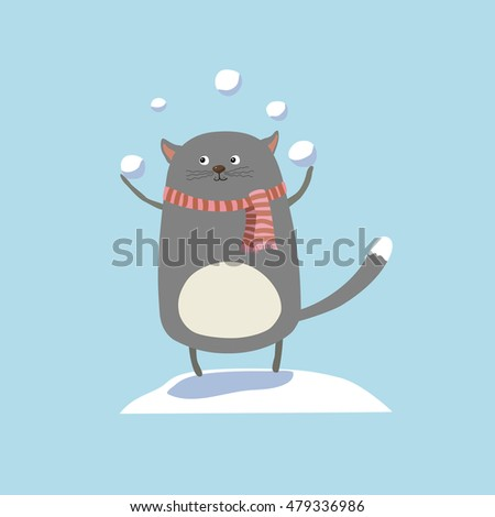 happy cat playing snowballs