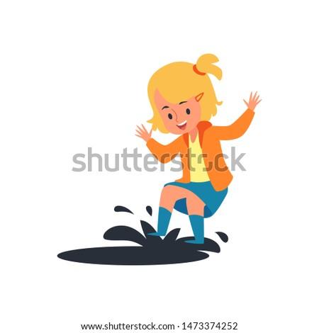 happy child jumping on rain