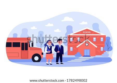 happy children walking from bus
