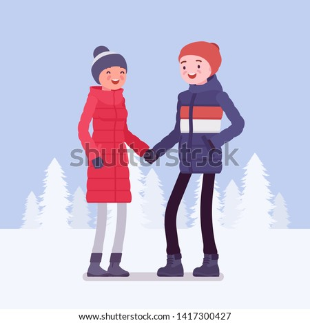 happy couple in winter clothes