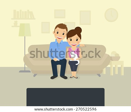 happy couple is watching tv at