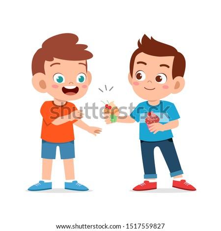 happy cute kid boy give friend cupcake