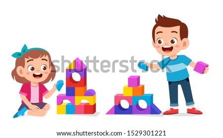 happy cute kids play brick block together Stockfoto ©
