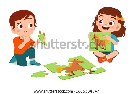 happy cute little kid boy and girl play jigsaw puzzle