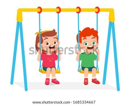 happy cute little kid boy and girl play swing ストックフォト ©