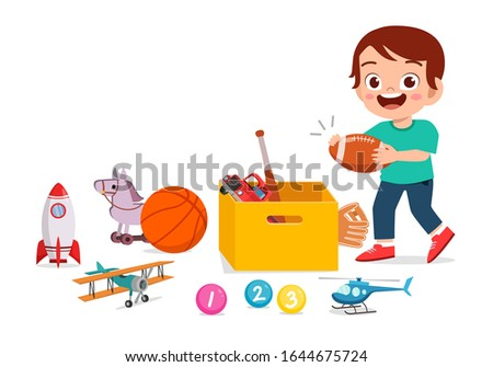 happy cute little kid boy playing with toys stock photo