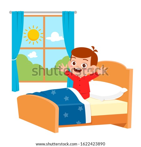 happy cute little kid boy wake up in the morning Stock photo ©