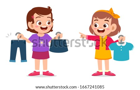 happy cute little kid girl choose clothes Stockfoto ©