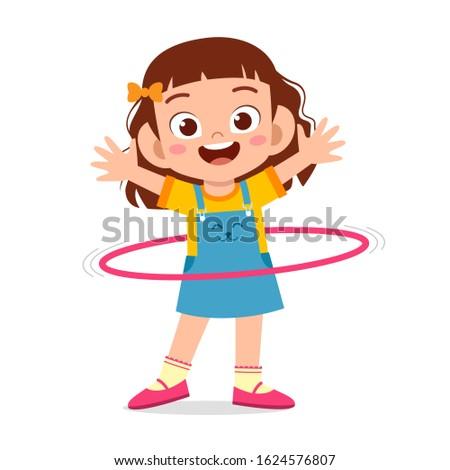 happy cute little kid girl play hula hoop