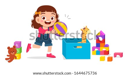 happy cute little kid girl playing with toys stock photo