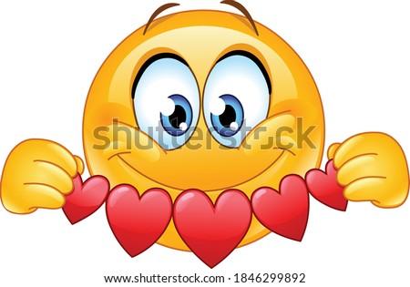 Happy emoji emoticon holding hearts garland bunting cutouts paper banner