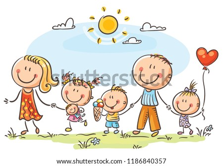 Happy family with three children walking outdoors and holding hands
