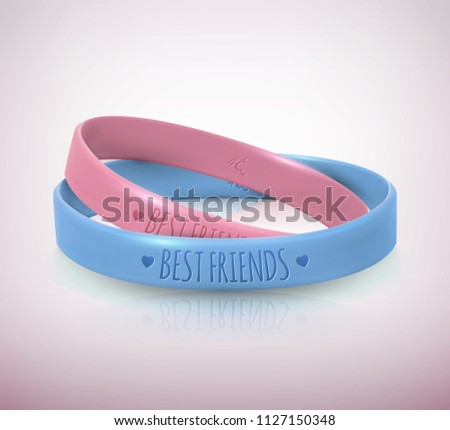 Happy Friendship Day. Realistic pink and blue rubbers friendship bracelets for best friends. Beautiful greeting card for holiday and celebration friends day. Vector illustration