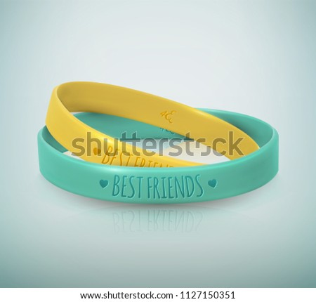 Happy Friendship Day. Realistic yellow and turquoise rubbers friendship bracelets for best friends. Beautiful greeting card for holiday and celebration friends day. Vector illustration
