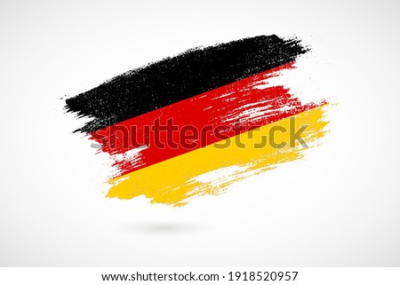 Happy German unity day of Germany with vintage style brush flag background Stockfoto ©