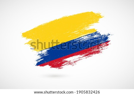 Happy independence day of Colombia with vintage style brush flag background Stock fotó ©