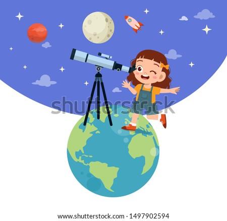 Happy kid studies astronomy with telescope.