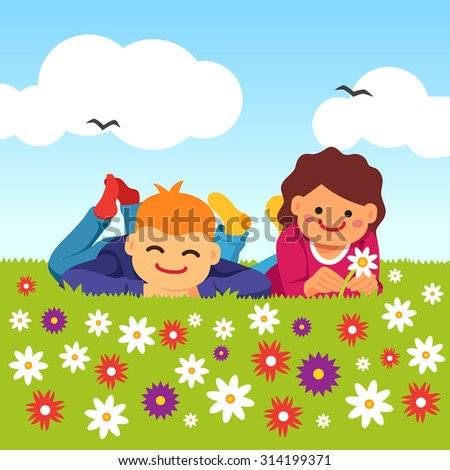 happy kids laying on the meadow
