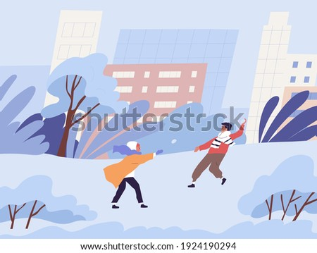 happy kids playing snowball in