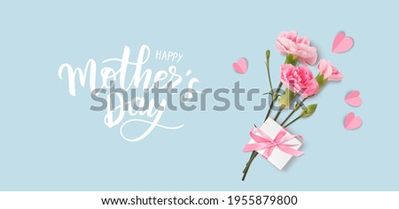 Happy Mothers day. Calligraphic greeting text. Holiday design template with realistic pink carnation flowers, gift box and hearts on blue background. Vector stock illustration.