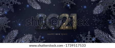Happy New Year 2021 beautiful sparkling design of numbers on dark elegant background with frame made of black snowflakes in paper cut style, beautiful fir branches and shining glitter.
