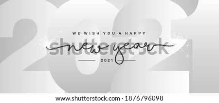 Happy New Year 2021 black handwritten lettering typography sparkle firework New Year 2021 into silver white background