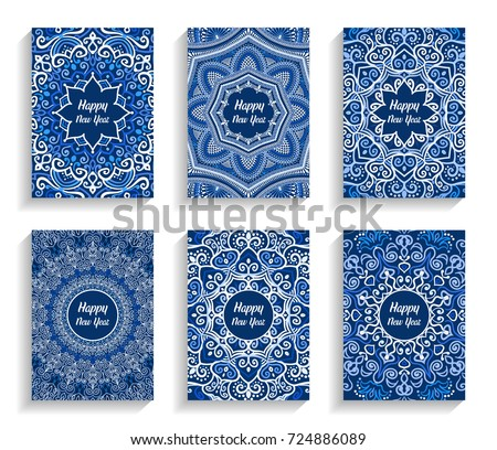 Happy New Year Cards. Vector text on flourish mandala backgrounds. 5 to 7 ratio. Abstract flowers in blue and white. Intricate design elements for print.