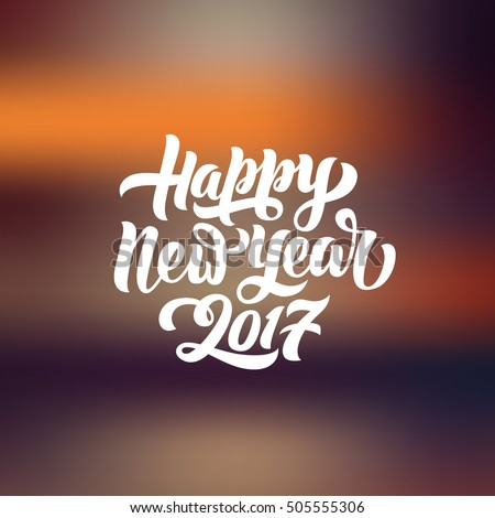 Happy New Year 2017 hand-lettering text on blurred background. Handmade vector calligraphy collection