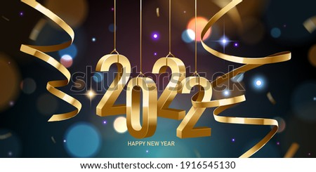 Happy New Year 2022. Hanging golden 3D numbers with ribbons and confetti on a defocused colorful, bokeh background.