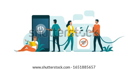 Happy people disconnecting and doing a digital detox, they are unplugging the phone and being offline Сток-фото ©