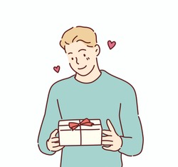 Happy smiling man holding gift box. Hand drawn style vector design illustrations.