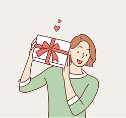 Happy smiling woman holding gift box. Hand drawn style vector design illustrations.