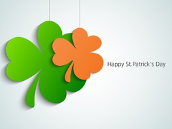 Happy St. Patrick's Day celebration with hanging clover leaves can be used as sticker or tag.
