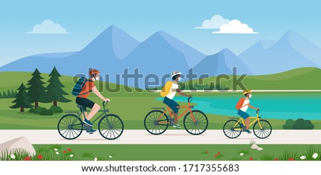 Happy traveling family spending time outdoors, they are cycling together in nature and wearing protective face masks