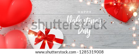 Happy Valentine's Day banner template. Vector illustration with shining lights garland, realistic gift boxes, air balloons and sparkling golden confetti on wooden texture. Holiday card. #1285319008