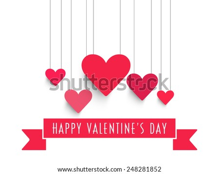 Shutterstock Happy Valentine's Day celebration with pink hanging hearts and ribbon on white background.