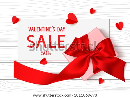Happy Valentines Day. Holiday Sale template design. Vector background with gift box, red bow, long ribbon and paper hearts. Top view. Paper with SALE text on wooden table and romantic love decorations