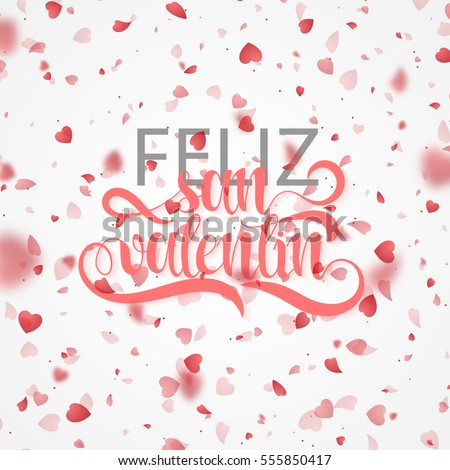 Happy Valentines Day. Phrase Spanish handmade. Feliz San Valentin. Bright red hearts flying in the form of petals on a white background. Festive banner and poster. Celebration pink texture