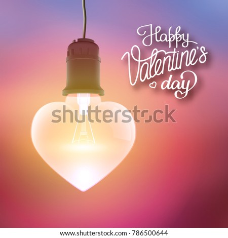 Happy Valentines Day template with calligraphic inscription and realistic hanging glowing bulb in heart shape vector illustration stock photo