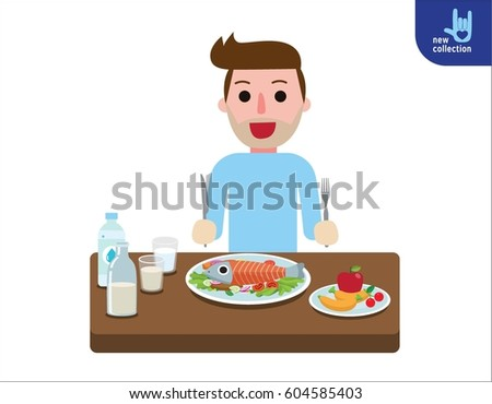 Happy young man eating healthy foods for lunch.