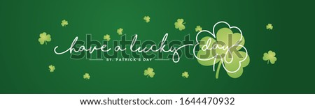Have a lucky day handwritten typography lettering line design St Patrick's Day green clovers background banner Stock photo ©