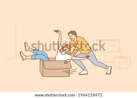 Having Fun during renovation in apartment concept. Happy young couple cartoon characters rolling in cardboard box during renovation and works or relocation vector illustration