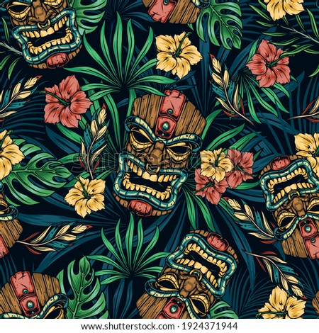 Hawaiian tropical colorful seamless pattern with tribal tiki mask hibiscus flowers monstera and palm leaves vector illustration