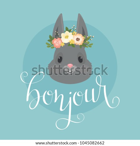 """Head of the rabbit/bunny in a floral wreath.  Hand lettering """"bonjour"""" in French. Vector Spring illustration #1045082662"""
