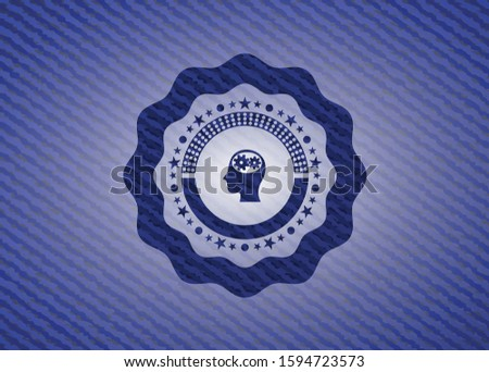 head with gears inside icon inside badge with denim background