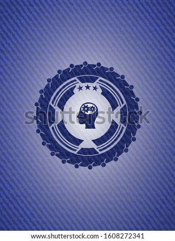 head with gears inside icon inside badge with jean texture