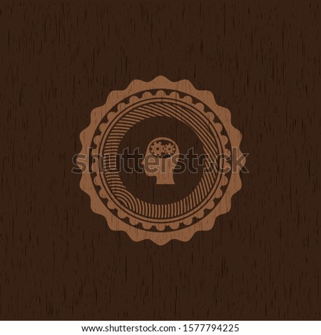 head with gears inside icon inside badge with wood background