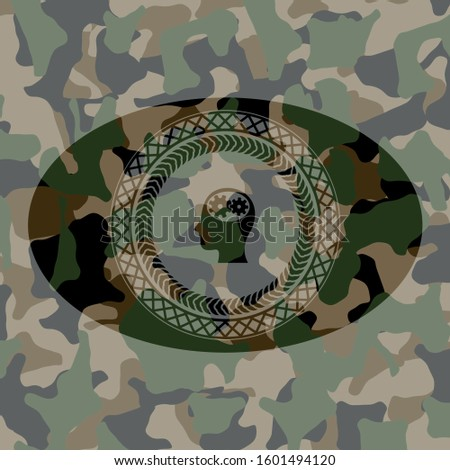 head with gears inside icon inside camo emblem