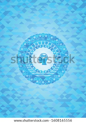 head with gears inside icon inside light blue mosaic emblem