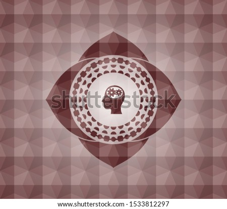 head with gears inside icon inside red seamless emblem with geometric pattern.